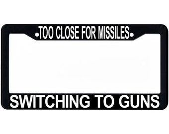 Too Close For Missiles Switching To Guns License Plate Frame, Line from Top Gun, Black and White