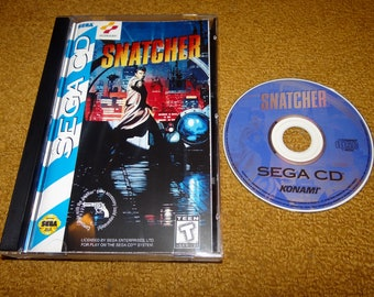 Sega CD Snatcher reproduction game CD, reprinted manual, case and case insert (see variations below)