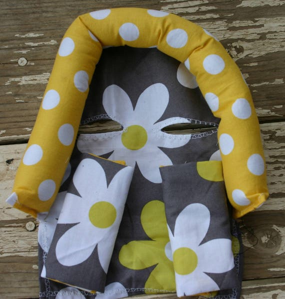 baby head support and/it strap covers daisy print with yellow and white polka dots