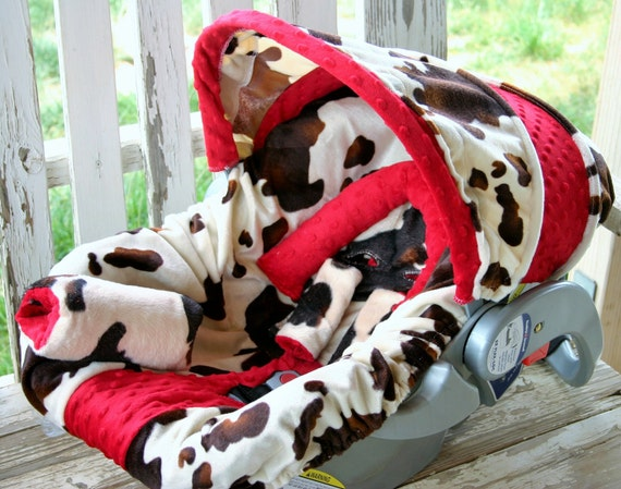 baby car seat cover and hood cover in Brown cow print with red minky