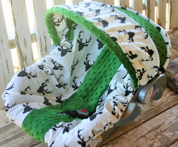 white with black buck marks and grass green minky infant car seat cover and hood cover