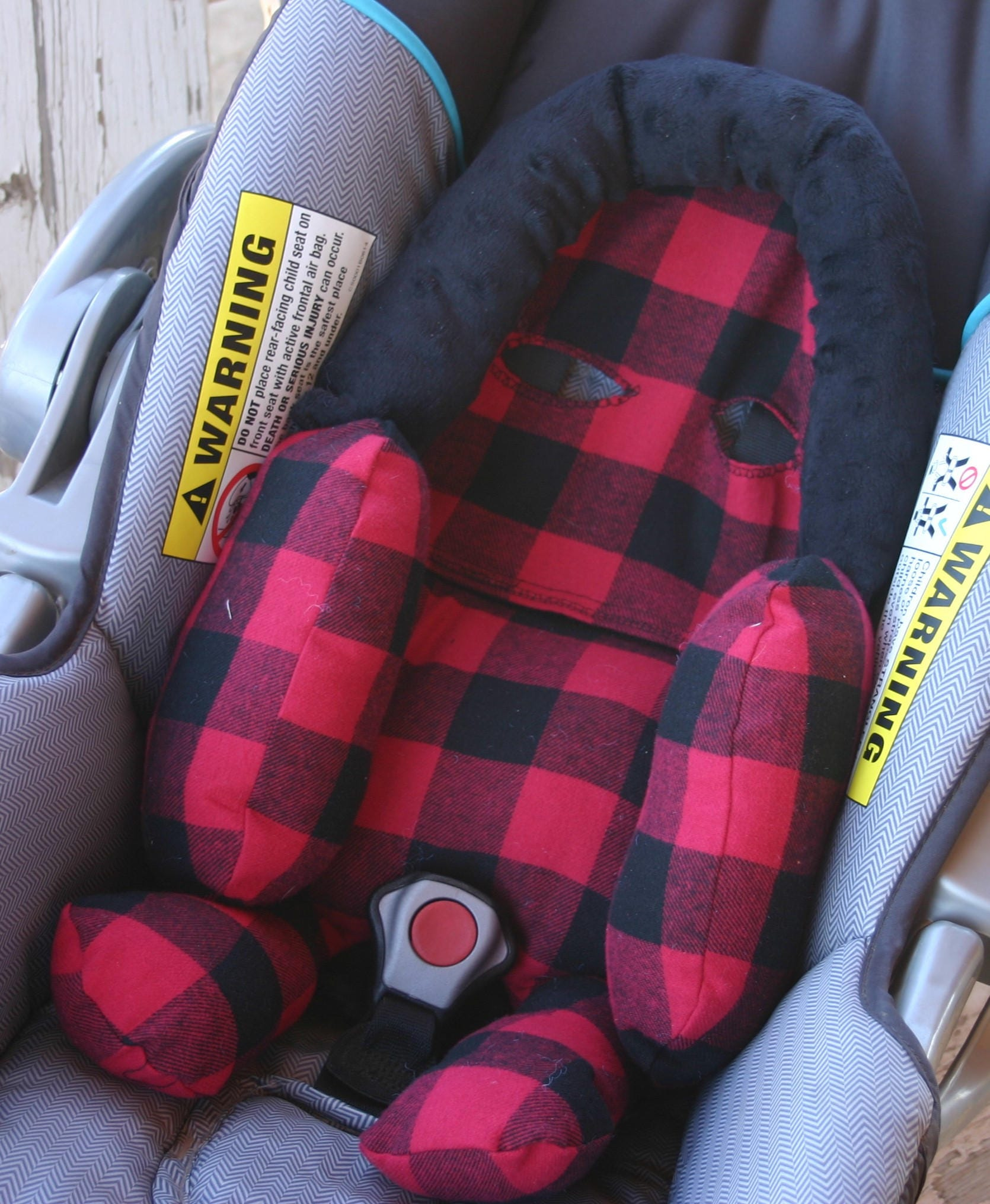 infant strap covers in red and black buffalo plaid with black minky