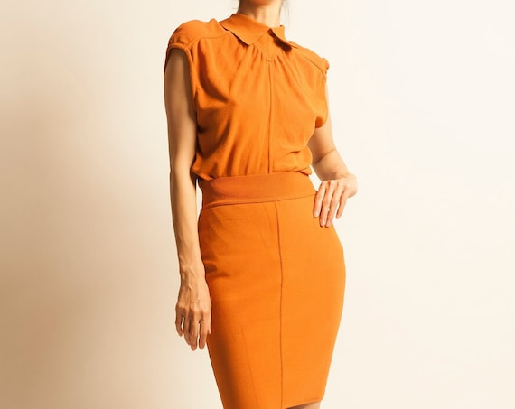 ALAIA 1980's orange bodysuit and skirt