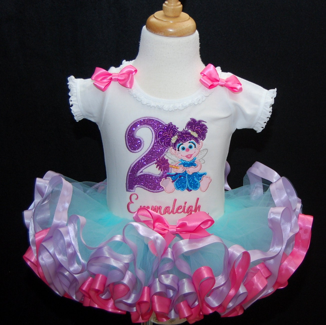 Sesame Street birthday dress featuring Abby Cadabby fully and fluffy ribbon trimmed tutu outfit for your babys 2nd birthday. Pesonalized