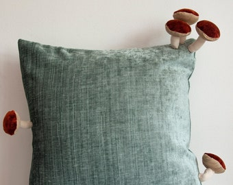 Fungimaa turquoise pillow with rusty brown mushrooms