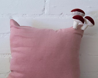 Fungimaa pink pillow with dark red leather mushrooms