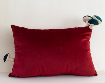 Fungimaa red pillow with green mushrooms
