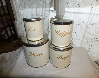 set 4 vintage Decoware nesting metal canisters round labeled cream dry storage retro kitchen rv decor