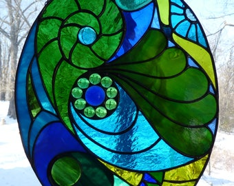 Blues and greens stained glass oval suncatcher