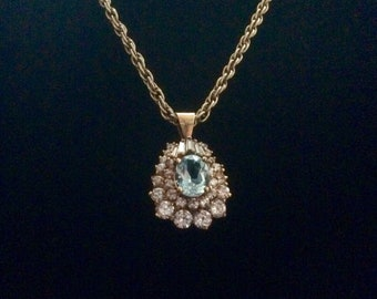 Light Blue Sapphire gold tone  and Clear Stone pendant necklace