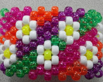 EDC white daisies with a rainbow glitter background.