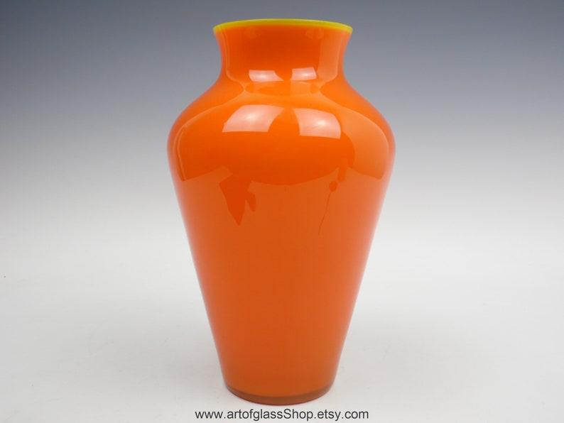 Vintage orange baluster shaped glass vase image 0