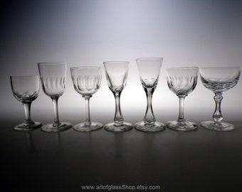 Mixed collection of 7 antique/vintage lens/petal cut glasses