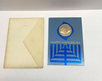 Vintage Happy Hanukkah greeting card with metal token attached.