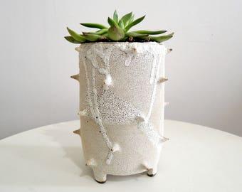 White lava spike ceramic planter, tripod planter
