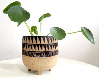 Black and tan triangle carved ceramic planter, tripod planter