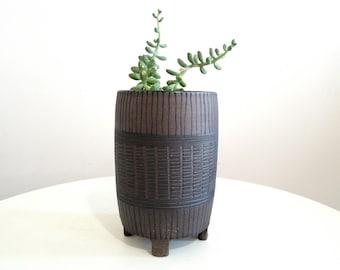 Black and dark brown striped ceramic planter, tripod planter