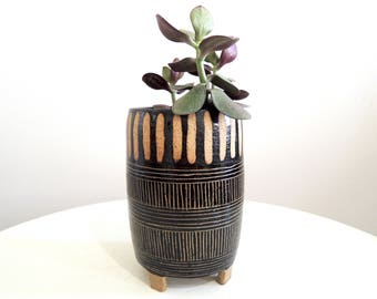 Black and tan striped ceramic planter, tripod planter