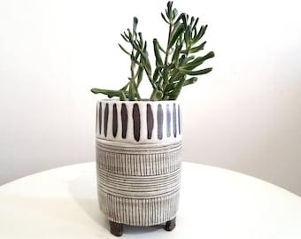Brown and white striped ceramic planter, tripod planter