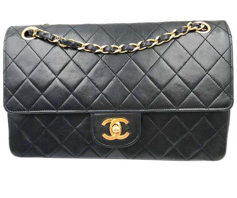 5e9c6a9a506e Chanel Black Lambskin Timeless 10 Double Flap 2.55