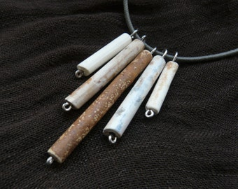 Necklace made from antique fragments of clay pipes gathered from the foreshores of the River Thames (V5)