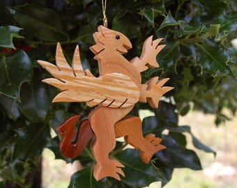 GRIFFIN CHRISTMAS ORNAMENT  A legendary mythical creature with body of a lion and and head, and wings of a bird.