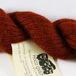 100% Qiviut, Rust Fingering weight, 220yds/oz, 1 ounce skein