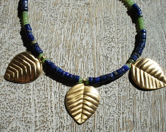 3 Gold leaf pendants embellish a necklace of Lapis Lazuli & lime green chalcedony gemstones. Recycled/ Boho/
