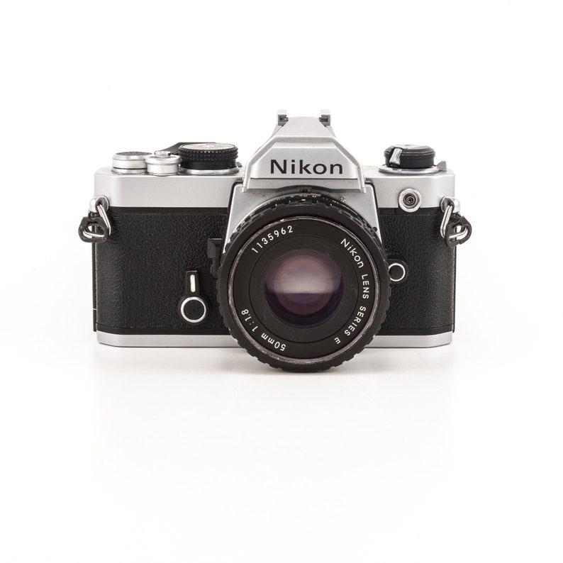 Nikon FM 35mm film camera with 50mm 1.8 Nikon prime lens image 0