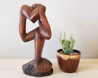 Handcarved wood sculpture of a figure with a heart | abstract art sculpture |