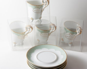 Four cups of coffee 70s rococo style.