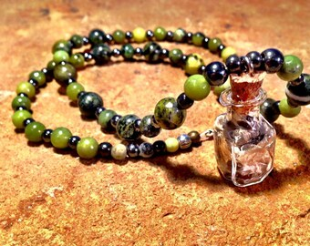 Serpentine stone necklace with snake skin pendant!