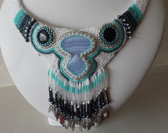 Blue Lace Agate and Gold Stone Cabaochons set into a Bib Style Necklace with Tassels and Amazonite