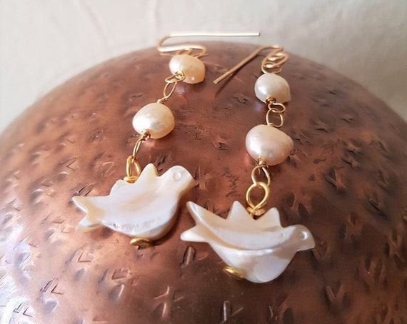 Cream Freshwater Pearls featuring A Mother of Pearl Dove Drop Earrings