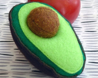 Life-like felt avocado is fun for children to remove and replace its seed.