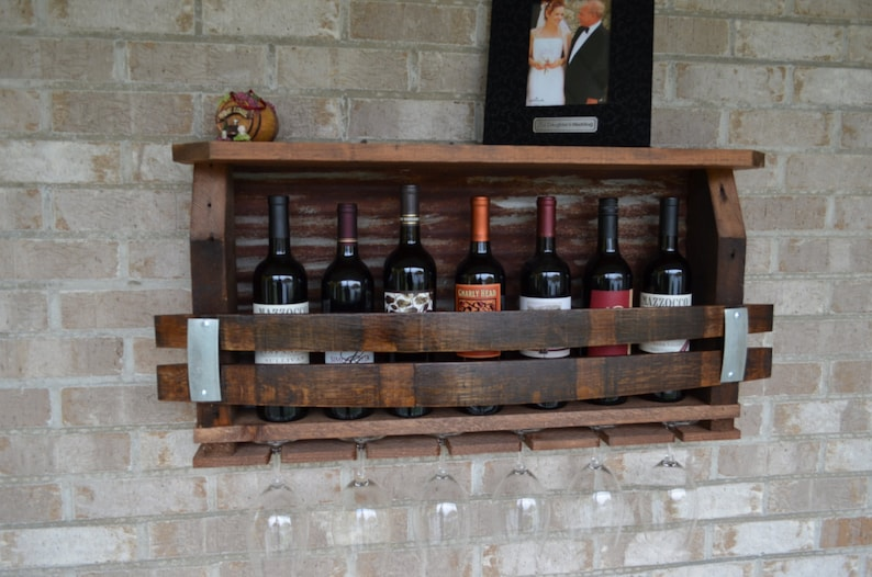 Wine Rack made from reclaimed barnwood Wine barrels and rusted Tin barn roof