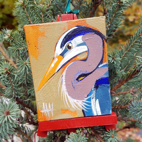 Great Blue Heron Ornament. For the Bird Lover on your list, a one-of-a-kind painting of this magnificent bird by Ashley Wolff