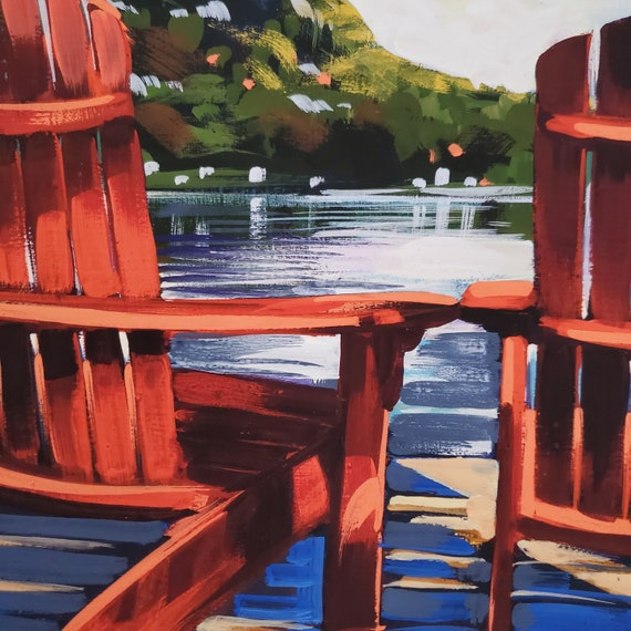 Adirondack chairs on a Lake Dunmore dock with a view of Mt. Moosalamoo, Vermont.