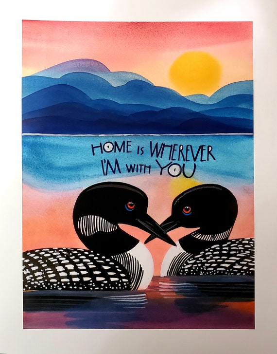 Two loons on a sunset lake with the quote: Home is wherever I am with you