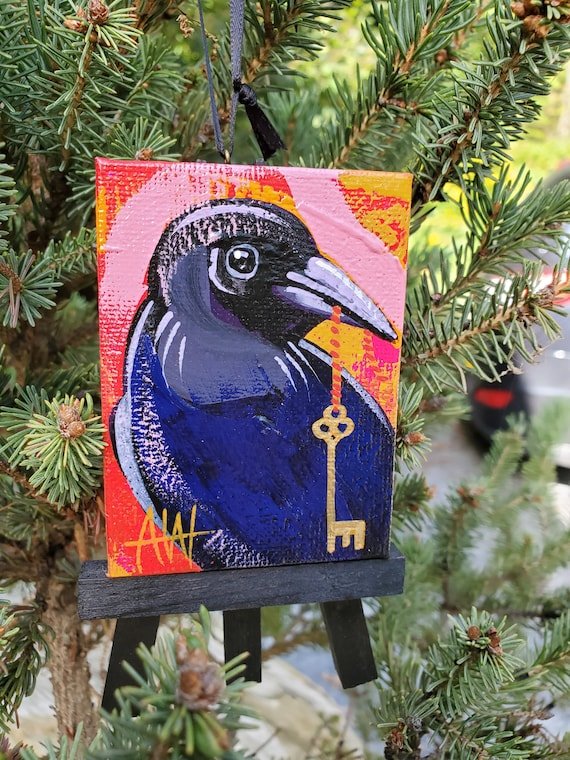 Raven with Key. For the Bird Lover on your list, a one-of-a-kind painting of this magnificent bird by Ashley Wolff