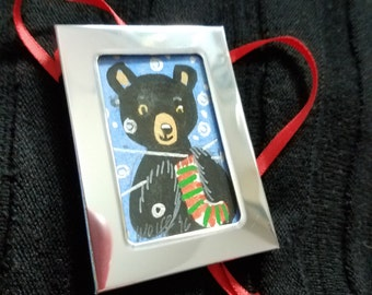 Baby Bear knits a red and green Christmas stocking just for you.