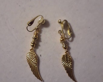 Gold feather clip on earrings
