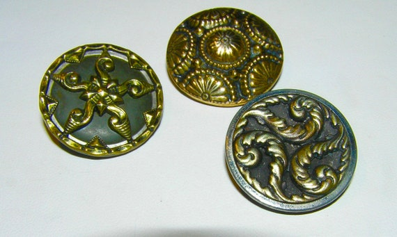 Two MediumLarge Antique Black Glass Domed Buttons Other with Geometric Surface One with Gold Luster