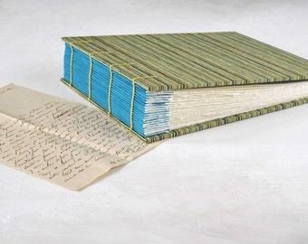 "Handmade photo album or scrapbook. Coptic bound that opens flat. Fits 4x6"" Photographs,"
