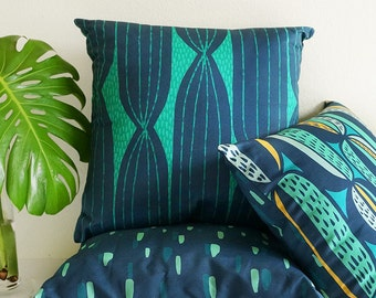 Modern Cactus Stripe throw pillow in navy and teal • original cactus-inspired textile • mid-century modern style