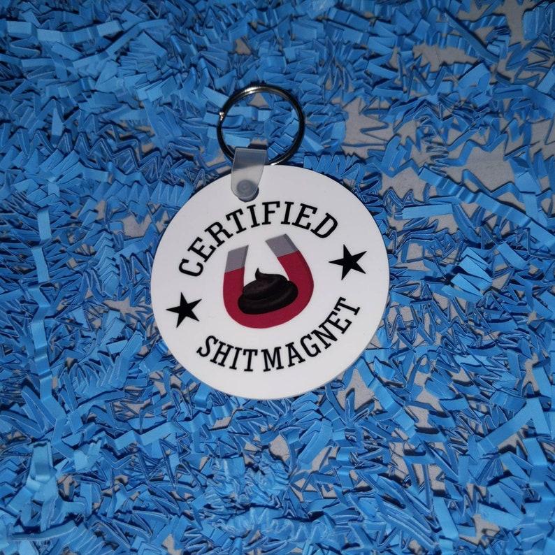Certified shit magnet 2 round keychain