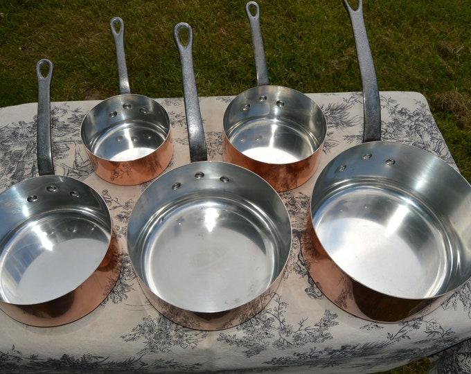Copper Pans Les Cuivres de Faucogney Set of Five Vintage French Copper Professional Graduated Pans Iron Handles 12-20cm Larger Set Dents