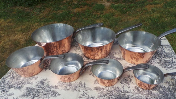 SERIE SPECIALE  Seven Vintage French Copper Professional Graduated Pans Cast Iron Handles Tin Lined Serie Speciale Copper Pans 10cm-22cm