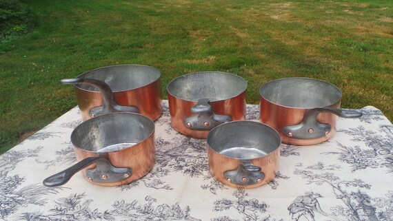 Ancient Copper Pans Set FIve BHV Paris Pans Bazar De L'Hotel De Ville Graduated Re Tinned Very Old Used Parisien Pans PItted Copper Losses