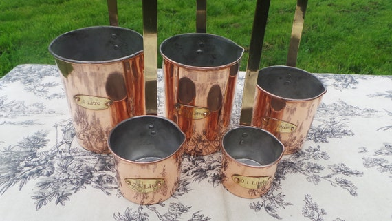 Vintage French Copper Set Five Graduated Measuring Pans Cups Ladles Brass Handles Pouring Spouts Good Heavy Set Good Patina Normandy Kitchen